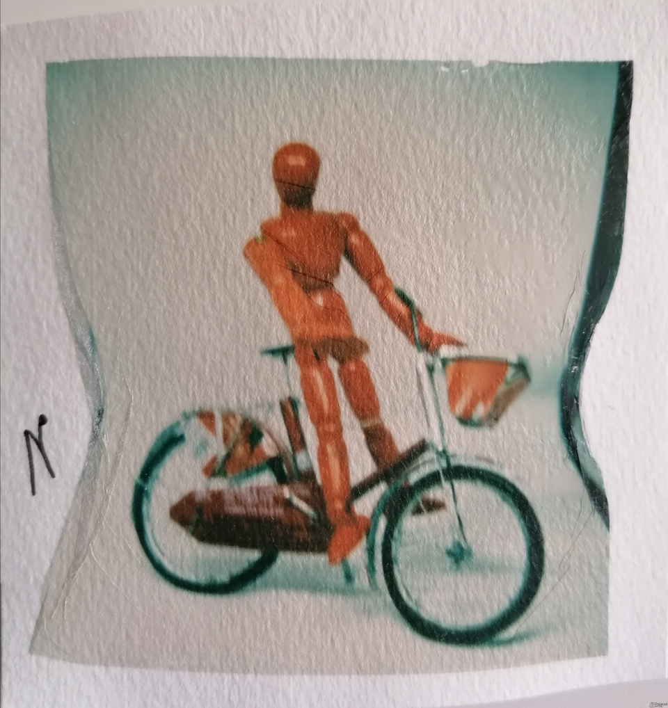 Red man on a red bike